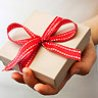 White box wrapped in red ribbon