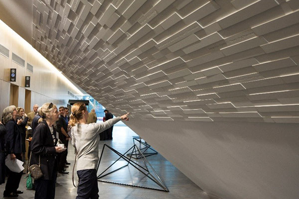 Onlookers searching for names on Pridham Hall's Inverted Pyramid