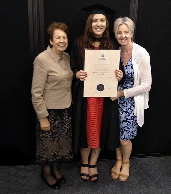 Stacey at her graduation, with her mother and grandmother